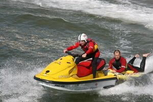 Two beach lifeguards on a rescue water craft