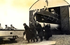 Black and white photo of the lady launchers hauling the Dungeness lifeboat