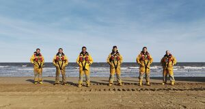 Bridlington ALB crew lined up on the beach in full kit.