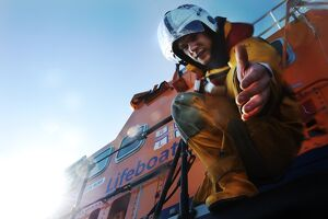 Crew member onboard Portrush Severn class lifeboat William Gordon Burr 17-30 reaching