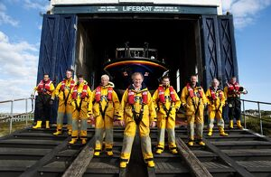 Group shot of Baltimore lifeboat crew stood on slipway.