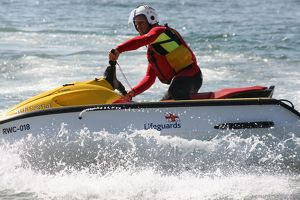 An RNLI lifeguard on a rescue water craft