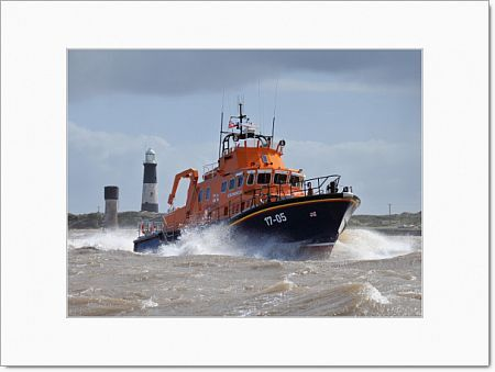 Humber severn class lifeboat Pride of the Humber 17-05. Lifeboat moving from left to right, lots of white spray, lighthouse in the background