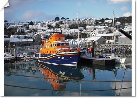 Penlee Severn Class Lifeboat 17-36 Ivan Ellen moored in Newlyn harbour and covered in snow