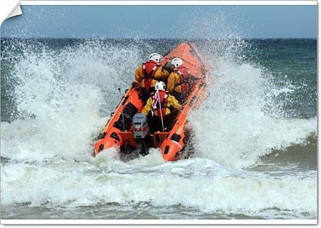 Cromer D-class inhsore lifeboat George and Muriel D-734 heading through a breaking wave following her naming ceremony