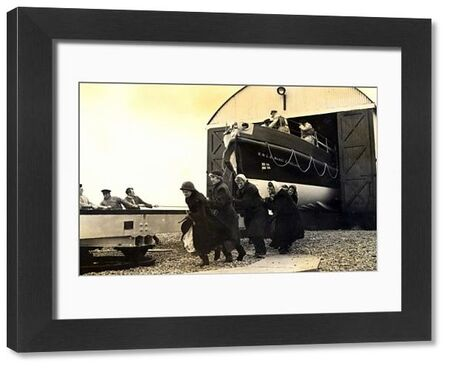 Black and white photo of the female shore helpers hauling the Dungeness lifeboat ON 937 Mabel E Holland lifeboat