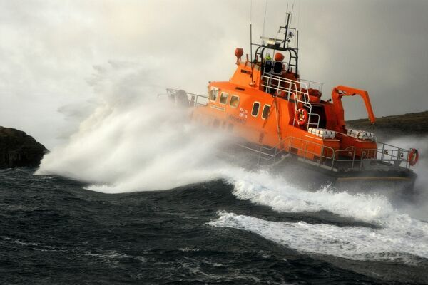 Barra Island severn class lifeboat the Edna Windsor, 17-12 ON 1230 moving from left to right in heavy seas. Lifeboat is moving away from the camera