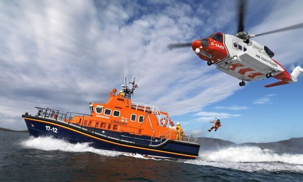 Royal Mail Rescue at Sea stamp launch at Barra. Coastguard helicopter is lowering a winchman onto the severn class lifeboat Edna Windsor 17-12 ON 1230