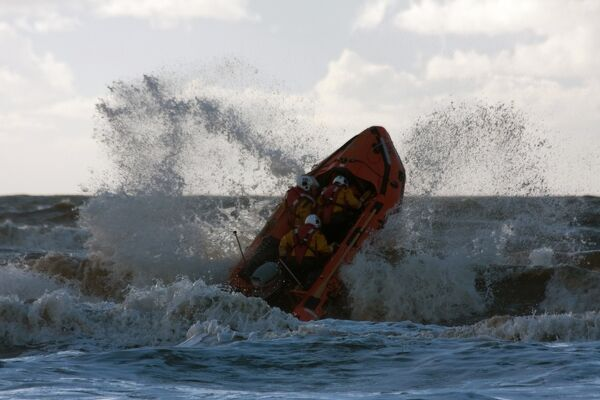 Blackpool D-class inshore lifeboat D-729 launching through a breaking wave