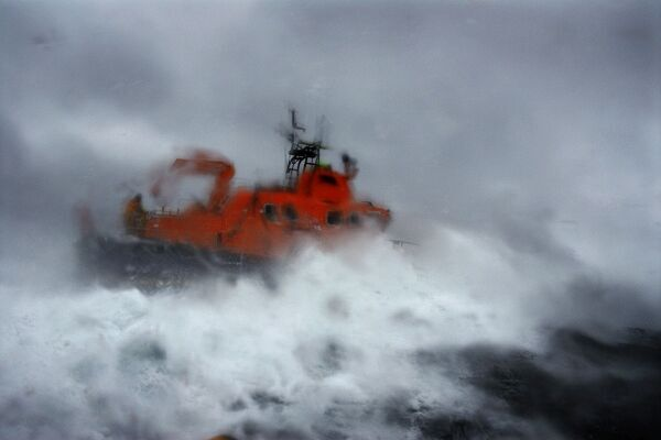Buckie Severn Class All Weather Lifeboat 17-37 William Blannin. Artistic shot through lens with water droplets on of Lifeboat in heavy seas