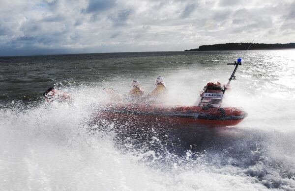 Burry Port Atlantic 75 inshore lifeboat Blue Peter II B-768. Lifeboat moving from right to left at speed, lots of white spray