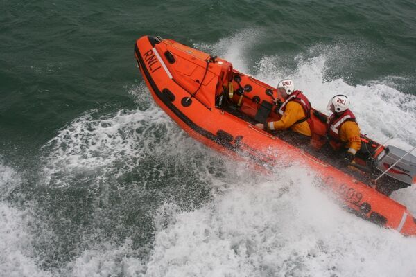 Calshot, D class, 248 Squardon RAF D-609. The Inshore lifeboat is moving at speed from right to left away from the camera