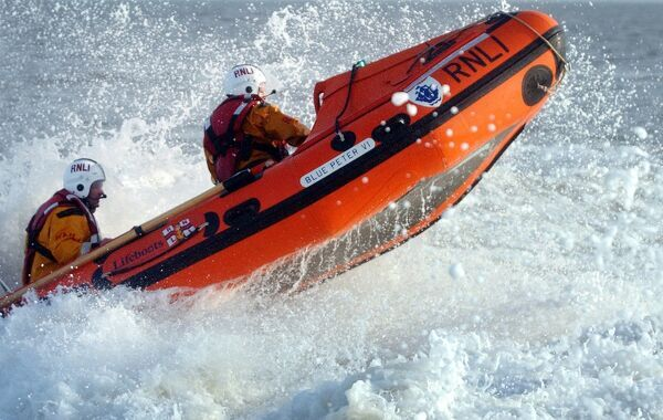 Cleethorpes D class lifeboat Blue Peter VI D-618. Bow out of the water and lots of spray