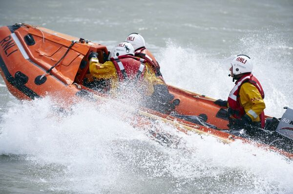 Eastbourne D-class inshore lifeboat Joan and Ted Wiseman 50 D-605. Close up shot, lifeboat moving from right to left, lots of white spray