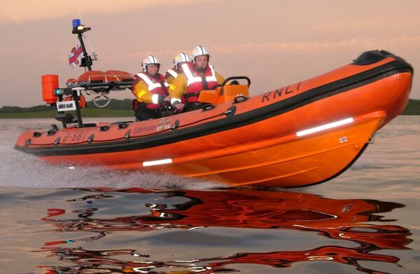 Enniskillen (Lower) Carrybridge B Class Atlantic 21 lifeboat, B 581 Andrew Mason on exercise at sunset with 3 crew aboard