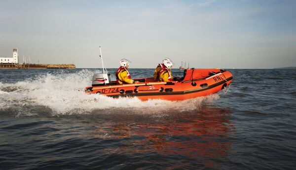 Exercise between Scarborough D-class inshore lifeboat and lifeguards.D-class John Wesley Hillard III D-724 lifeboat moving from left to right