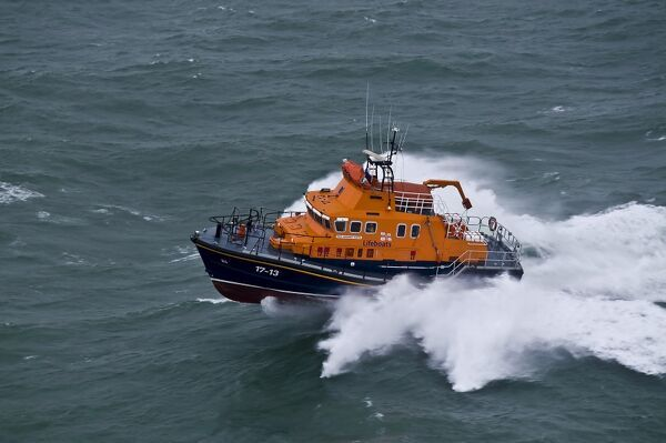 Kirkwall severn class lifeboat Margaret Foster 17-13. Lifeboat is moving from right to left, shot from helicopter during service to vessel Inanna off Stronsay