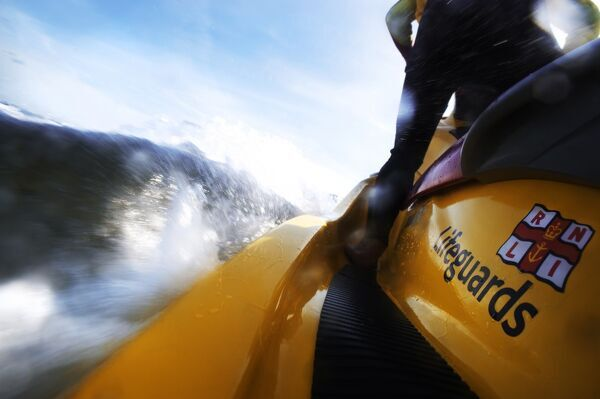 Lifeguard on rescue watercraft at Scarborough beach. Shot from the sled behind the RWC looking forwards