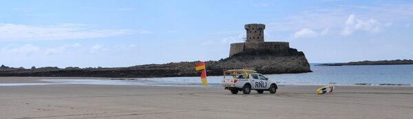 Lifeguards monitoring the sea at a beach in Jersey from within a lifeguard patrol vehicle. Panoramic shot