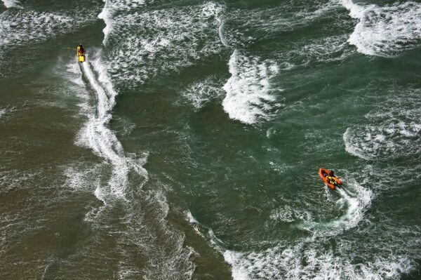 Lifeguards on a rescue watercraft (RWC) and arancia inshore rescue boat shot from Culdrose helicopter in St Ives