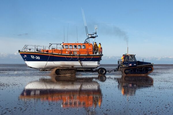 Lytham St Annes Mersey class lifeboat Her Majesty the Queen 12-30 being recovered by tractor on the beach after an exercise