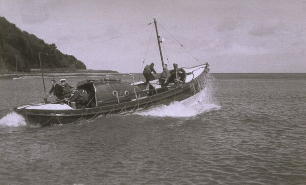 Minehead lifeboat Liverpool Motor class ON 882 'B. H. M. H.' travelling from left to right in a calm sea. 5 men on board. Seascape, broken clouds. PART OF GRAHAME FARR ARCHIVES