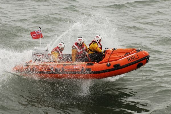 The naming ceremony of Southend on Sea D class inshore lifeboat The Essex Freemason D-682. Lifeboat is moving from left to right at speed, white spray