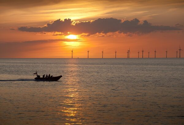 New Brighton Atlantic 85 inshore lifeboat B-837 Charles Dibdin on way to a rescue in Crosby on the other side of the River Mersey at sunset. The windfarm in the background is in Liverpool Bay. Shortlisted finallist for Photographer of the Year 2012