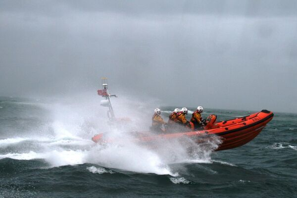 Poole Atlantic 85 class inshore lifeboat Sgt Bob Martin B-826 in rough seas heading from left to right