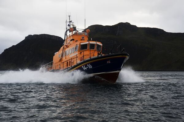 Portree trent class lifeboat Stanley Watson Barker 14-16 moving from left to right, crew on the stern and upper steering position