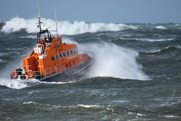 Portrush trent class lifeboat Dora Foster Mcdougall 14-24 moving from left to right in heavy seas, lots of white water