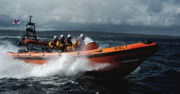 Red Bay Altantic 85 inshore lifeboat Geoffrey Charles B-843. Lifeboat moving from left to right at speed, four crew on board
