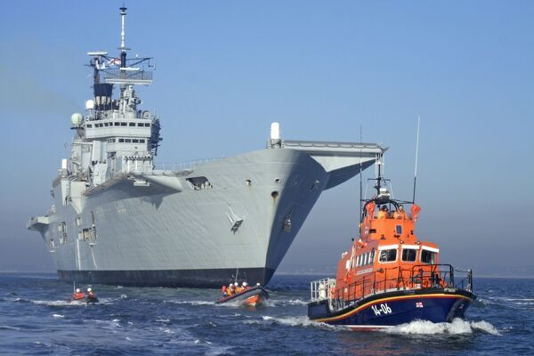 The Royal Navy flagship aircraft carrier HMS Ark Royal in Poole to take part in a training session with D-class and Atlantic inshore lifeboats, and the trent class lifeboat Windsor Runner 14-06 ON 1204 in aid of the Train One Save Many appeal