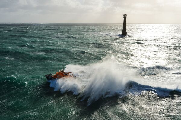 St Marys Severn class lifeboat 17-11 in rough seas off the lighthouse at Bishops Rock