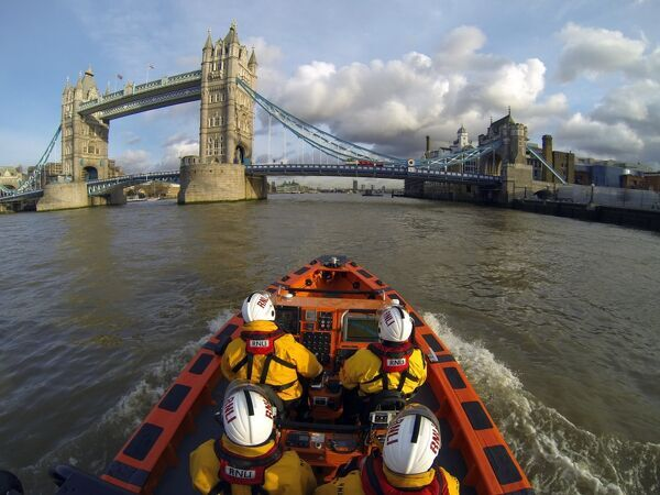 Tower E-class lifeboat Hurley Burly E-07 heading along the Thames towards Tower Bridge
