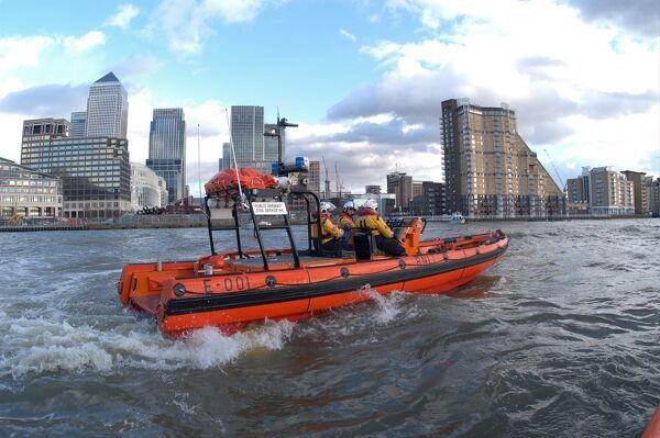 Tower Pier. E class. E-001, Public Servant (Civil service 44) Close up of E class lifeboat with three crew visible