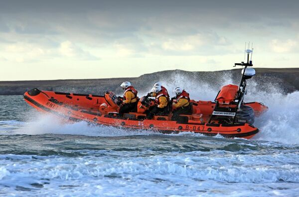 Trearddur Bay Atlantic 85 inshore lifeboat Hereford Endeavour B-847. Lifeboat moving from right to left at speed, foud crew on board