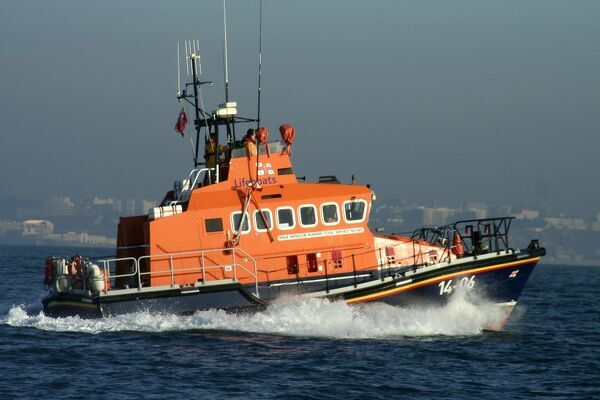 Trent class lifeboat Windsor Runner 14-06 ON 1204. Lifeboat is moving from left to right, bright sunny day