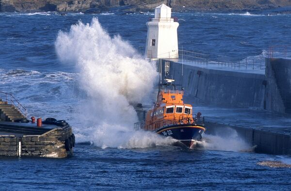 Wick Trent class all weather lifeboat ON 1226 Edward Duke of Windsor 14-22. Approaching bow on through the harbour entrance at speed in a rough sea