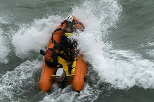 An arancia inshore rescue boat in heavy surf at Perranporth