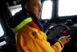 Barra Island coxswain Donald MacLeod inside the wheelhouse of the severn class lifeboat