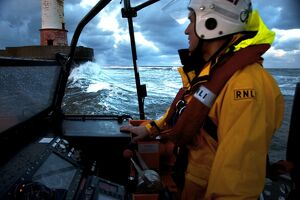 Coxswain stood at the helm of the Berwick-upon-Tweed Mersey class lifeboat Joy