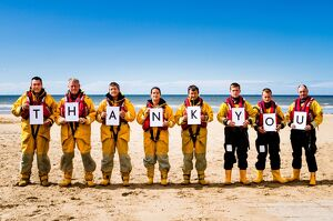 Crew members at Rhyl holding up letters spelling out the words Thank You