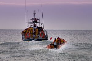 Hastings all weather and inshore lifeboats at sea