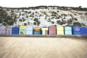 Landscape shot of the colourful beach huts at Broadstairs