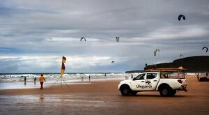 Lifeguards monitoring the beach from a patrol vehicle