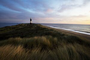 Lighthouse at Spurn Point, Humber, at sunrise.