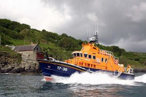 Penlee Severn Class Lifeboat 17-36 Ivan Ellen sailing past the old Penlee boathouse