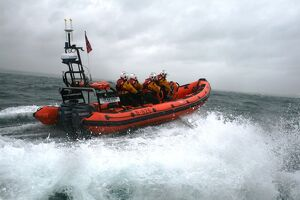 Poole Atlantic 85 class inshore lifeboat Sgt Bob Martin in rough seas.