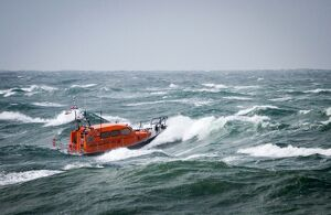 Prototype Shannon class FCB2 lifeboat in rough seas off Portland Bill.
